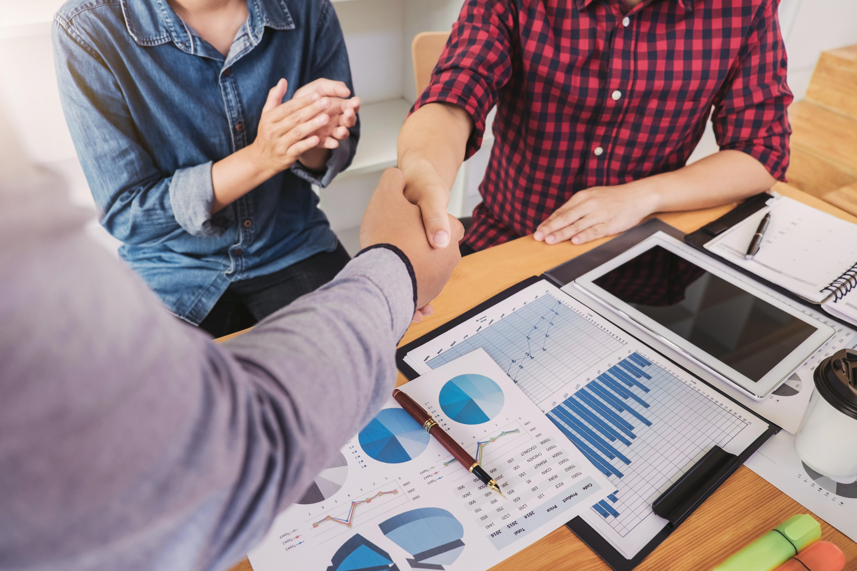 A handshake between inbound marketing companies and sales teams